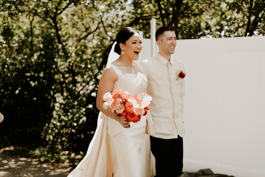 Wedfuly bride, Justine experiences a moment of pure joy at her virtual wedding.